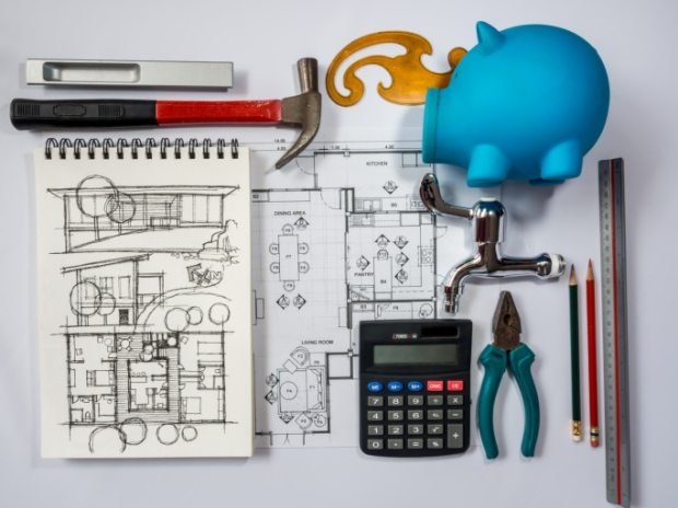 Piggy bank, architecture drawing and equipment/ home remodel saving concept