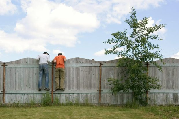 bigstock-two-boys-on-the-fence-looking-89532188-768x512