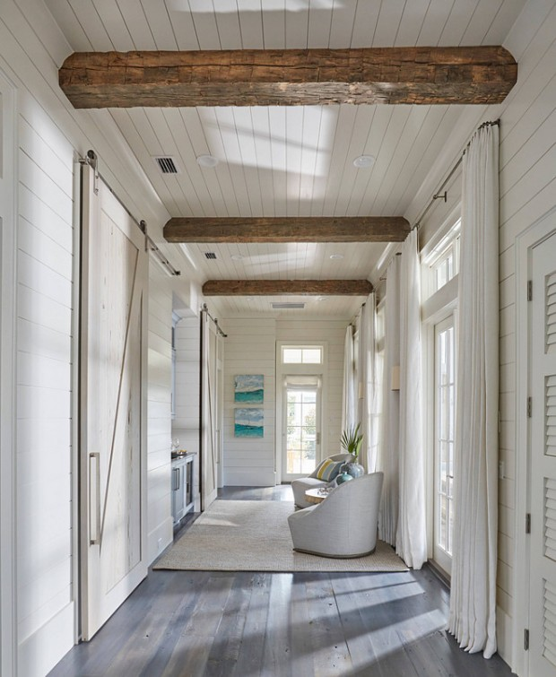 floor-to-ceiling-shiplap-paneling-with-reclaimed-wood-beam