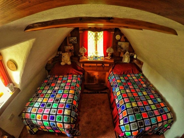 The hobbit houses practical use of space only adds to its magical appeal in the bathroom youll find a washing machine hidden in a nook next to the